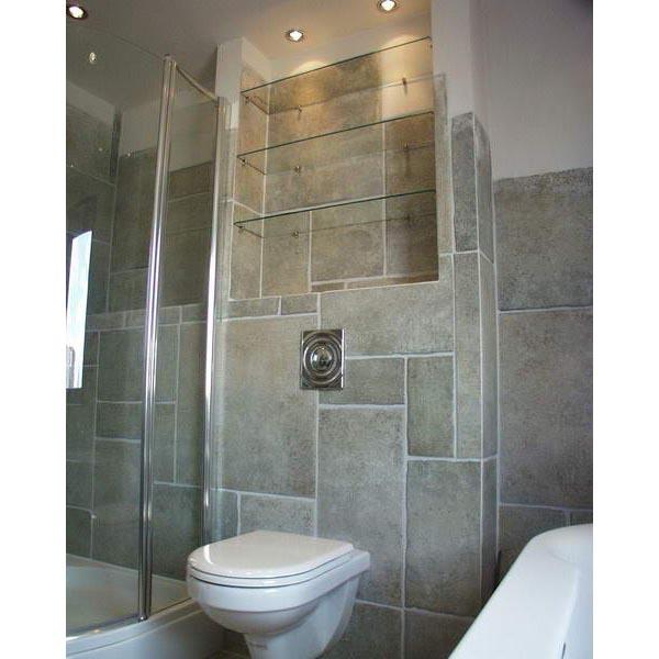 Badkamer Amersfoort halfvrijstaand ligbad met tegel stucwerk combinatie